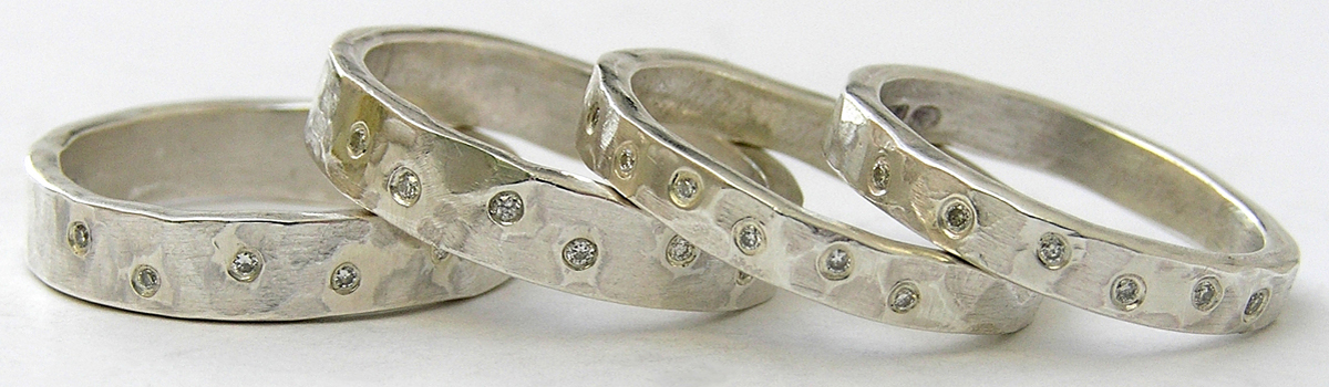 Dimpled silver slim and wide rings with scatter diamonds - header